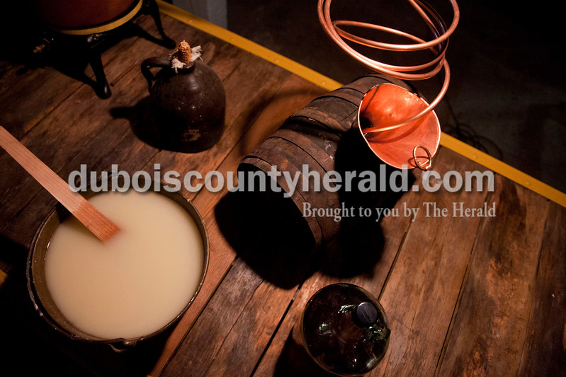 "Carolyn Van Houten/The Herald<br /> The traditional equipment required to make moonshine was on display during the ""Party like it's 1929!"" event at the Dubois County Museum in Jasper on Saturday.  The evening event was themed around the prohibition days, featuring a moonshine demonstration, costume contest, and live music by the Recycled Teenagers."