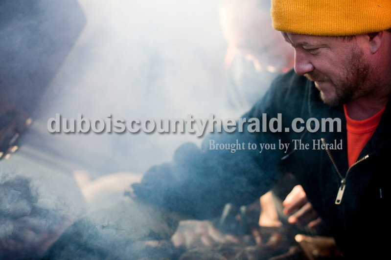 "Carolyn Van Houten/The Herald<br /> Firefighter Cory Voegerl of Dubois grilled sausages during the benefit breakfast for Firefighter Clint Eichmiller and his family at the Dubois Volunteer Fire Department on Sunday morning.  The Eichmillers lost their entire home and all of their possessions in a fire on February 28, 2014.  Over 400 people came to the benefit breakfast to support the family.  ""The turnout this morning is really overwhelming,"" Eichmiller said."