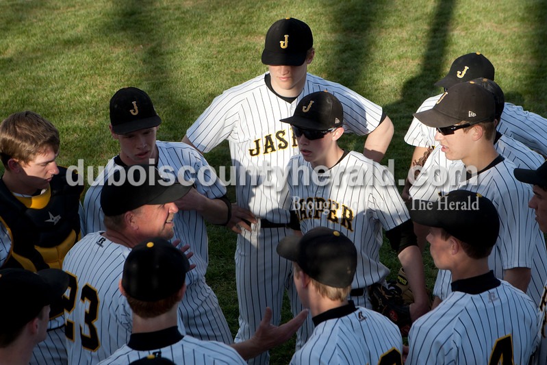 Heather Rousseau/The Herald<br /> Coach Terry Gobert gave his team a pep-talk between innings during Monday night's baseball game against New Trier in Jasper. Jasper lost 5-4.