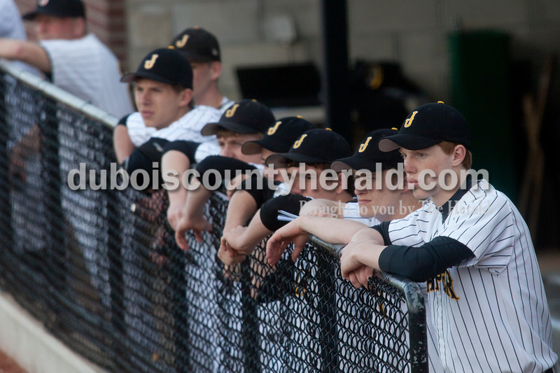 Jasper's Tate Blessinger, front right,  Cody Jacob and Zach Keusch stood with their team in the dugout and watched Monday night's game against New Trier in Jasper. Jasper lost 5-4.