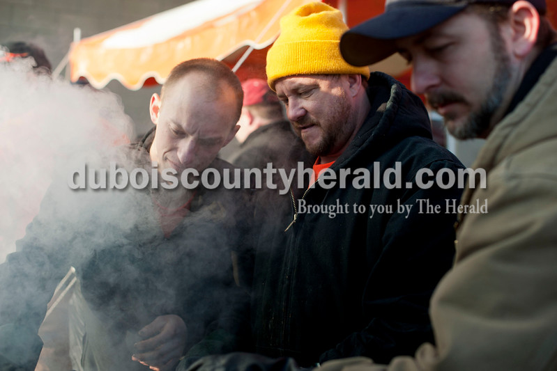 "Carolyn Van Houten/The Herald<br /> Firefighters Derek Breitwieser of Cuzco, left, Cory Voegerl of Dubois, and Glen O'Brian of Crystal grilled sausages during the benefit breakfast for Firefighter Clint Eichmiller and his family at the Dubois Volunteer Fire Department on Sunday morning.  The Eichmillers lost their entire home and all of their possessions in a fire on February 28, 2014.  Over 400 people came to the benefit breakfast to support the family.  ""The turnout this morning is really overwhelming,"" Eichmiller said."