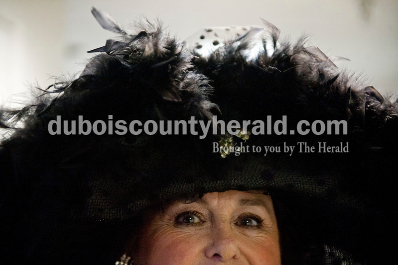 "Carolyn Van Houten/The Herald<br /> Jennifer Wohlberg of Jasper talked about her derby hat while posing for a portrait during the ""Party like it's 1929!"" event at the Dubois County Museum in Jasper on Saturday.  The evening event was themed around the prohibition days, featuring a moonshine demonstration, costume contest, and live music by the Recycled Teenagers."