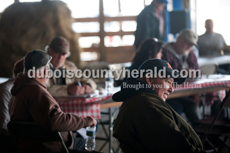 Carolyn Van Houten/The Herald<br /> Dr. Mark Bickers of Floyds Knobs sat and listened to the auctioneer during J&D Kerstiens Gelbvieh Going to Grass Bull Sale in Huntingburg on Saturday.  They auctioned 27 bulls during the sale.