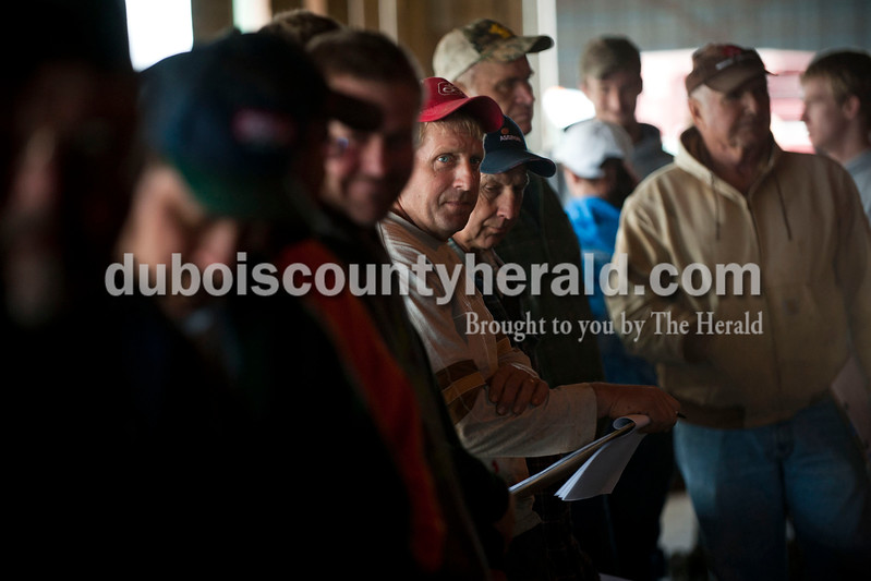 Carolyn Van Houten/The Herald<br /> Pat Luecke of New Boston listened with other potential buyers during J&D Kerstiens Gelbvieh Going to Grass Bull Sale in Huntingburg on Saturday.  They auctioned 27 bulls during the sale.