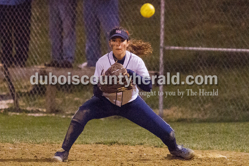 Heritage Hills' Madison Gogel prepared to catch a throw for a tag out against Jasper during Tuesday night's game in Lincoln City. Heritage Hills won 5-3. Rachel Mummey/The Herald