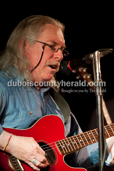 Carolyn Van Houten/The Herald<br /> Ed Walston of St. Anthony played guitar and sang during the Will Read and Sing for Food event at the Astra Theatre in Jasper on Sunday.  The event was hosted by the Dubois County Community Foundation and the proceeds went to the foundation's grants for charities in Dubois County.
