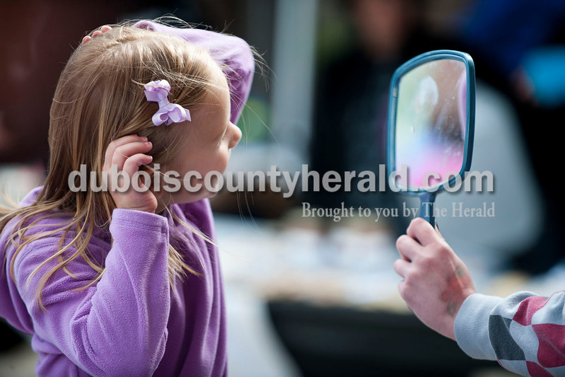 Carolyn Van Houten/The Herald<br /> Leah Jerger of Jasper, 5, looked in a mirror after getting a unicorn painted on her face during the 11th Annual Chalk Walk Arts Festival in Jasper on Saturday.  The event, which is put on by the Jasper Community Arts Commission, transforms the sidewalks on the Square into huge murals made with colorful chalk.