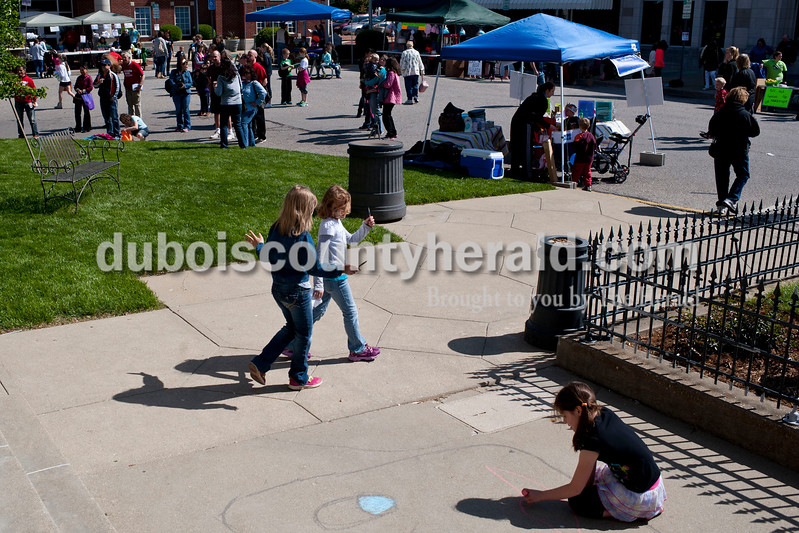 Carolyn Van Houten/The Herald<br /> People gathered on the Square to shop, eat, draw, craft and listen to local music during the 11th Annual Chalk Walk Arts Festival in Jasper on Saturday.  The event, which is put on by the Jasper Community Arts Commission, transforms the sidewalks on the Square into huge murals made with colorful chalk.