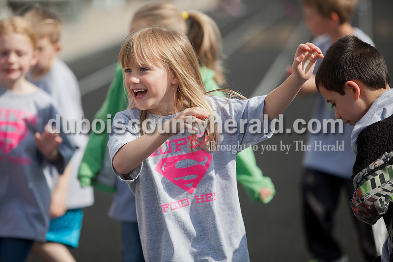 Rachel Mummey/The Herald<br /> First-graderJasmine Nicastro swayed her arms back and forth while warming up during Fifth Street Elementary School's fourth annual Whiskers Walk at Jerry Brewer Alumni Stadium on Friday. The event encouraged kids in all grades to walk for thirty minutes to raise awareness of childhood obesity and promote health and wellness.