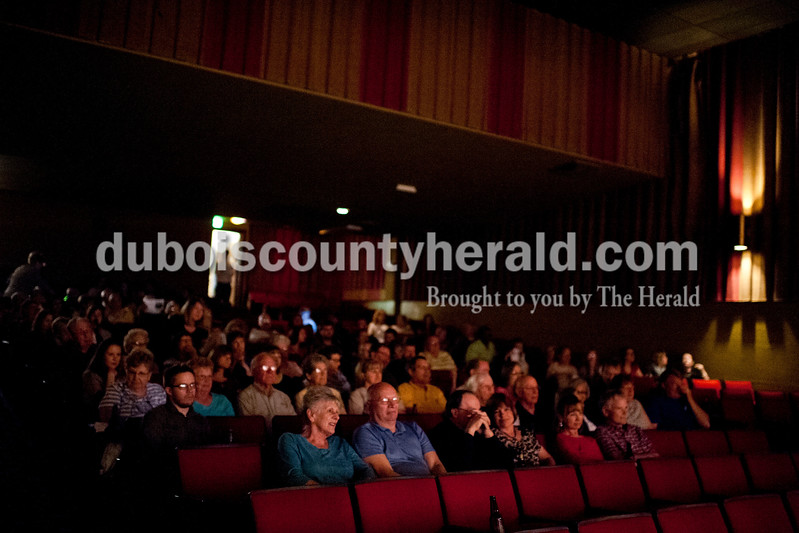 Carolyn Van Houten/The Herald<br /> The audience listened to Scott Saalman of Jasper read during the Will Read and Sing for Food event at the Astra Theatre in Jasper on Sunday.  The event was hosted by the Dubois County Community Foundation and the proceeds went to the foundation's grants for charities in Dubois County.