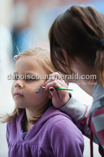 Carolyn Van Houten/The Herald<br /> Leah Jerger of Jasper, 5, got a unicorn painted on her face during the 11th Annual Chalk Walk Arts Festival in Jasper on Saturday.  The event, which is put on by the Jasper Community Arts Commission, transforms the sidewalks on the Square into huge murals made with colorful chalk.