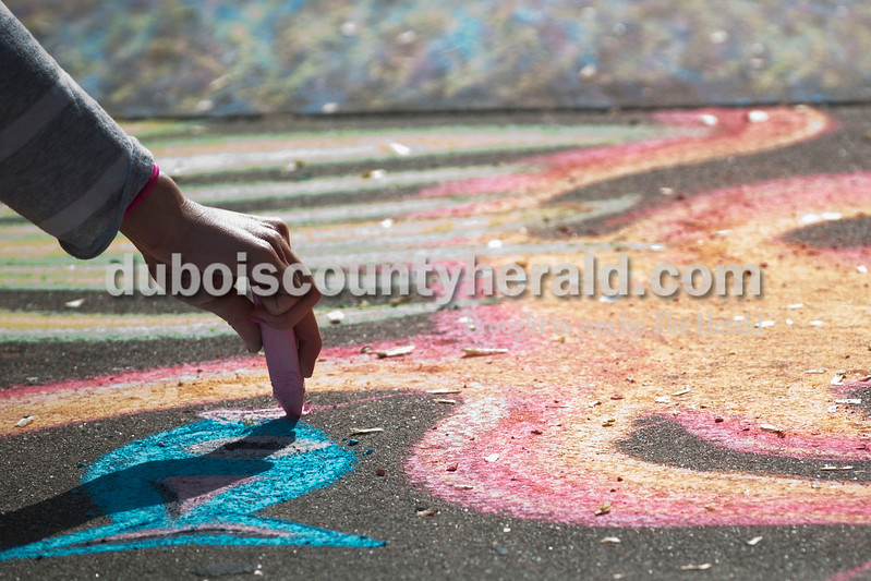 Carolyn Van Houten/The Herald<br /> Hannah Brescher of Indianapolis drew an underwater scene during the 11th Annual Chalk Walk Arts Festival in Jasper on Saturday.  The event, which is put on by the Jasper Community Arts Commission, transforms the sidewalks on the Square into huge murals made with colorful chalk.