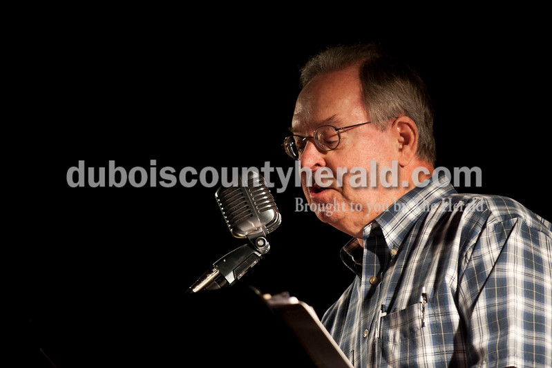 Carolyn Van Houten/The Herald<br /> Greg Eckerle of Jasper read a story during the Will Read and Sing for Food event at the Astra Theatre in Jasper on Sunday.  The event was hosted by the Dubois County Community Foundation and the proceeds went to the foundation's grants for charities in Dubois County.