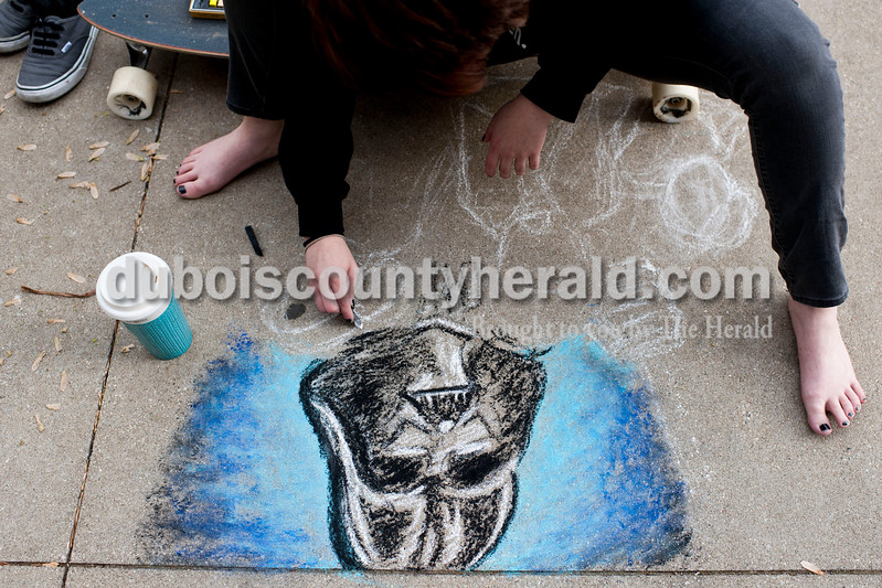 Carolyn Van Houten/The Herald<br /> Alana Rasche of Jasper, 17, drew Star Wars characters during the 11th Annual Chalk Walk Arts Festival in Jasper on Saturday.  The event, which is put on by the Jasper Community Arts Commission, transforms the sidewalks on the Square into huge murals made with colorful chalk.