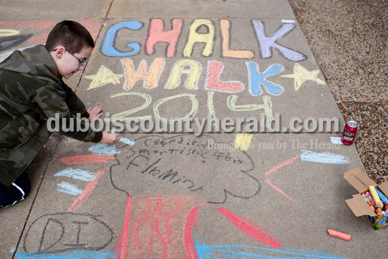 Carolyn Van Houten/The Herald<br /> Casey Haggh of Jasper, 8, drew his Destination Imagination team's logo during the 11th Annual Chalk Walk Arts Festival in Jasper on Saturday.  The event, which is put on by the Jasper Community Arts Commission, transforms the sidewalks on the Square into huge murals made with colorful chalk.