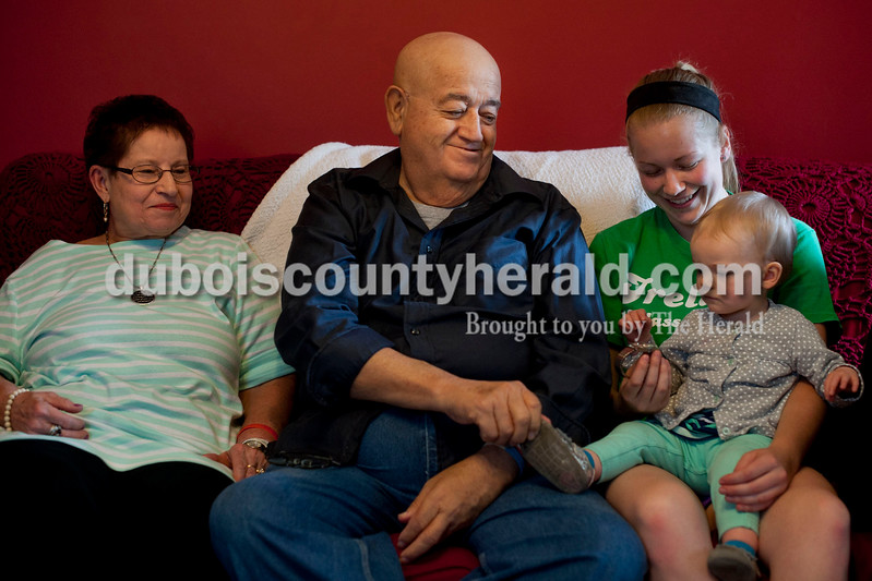 Carolyn Van Houten/The Herald<br /> Don Lichlyter, center, sat with his wife Pete Lichlyter, left, his granddaughter Kendra Kern and his great-granddaughter, Reese Schnaus, 1, at his home in Jasper on Wednesday.  All are of Jasper.