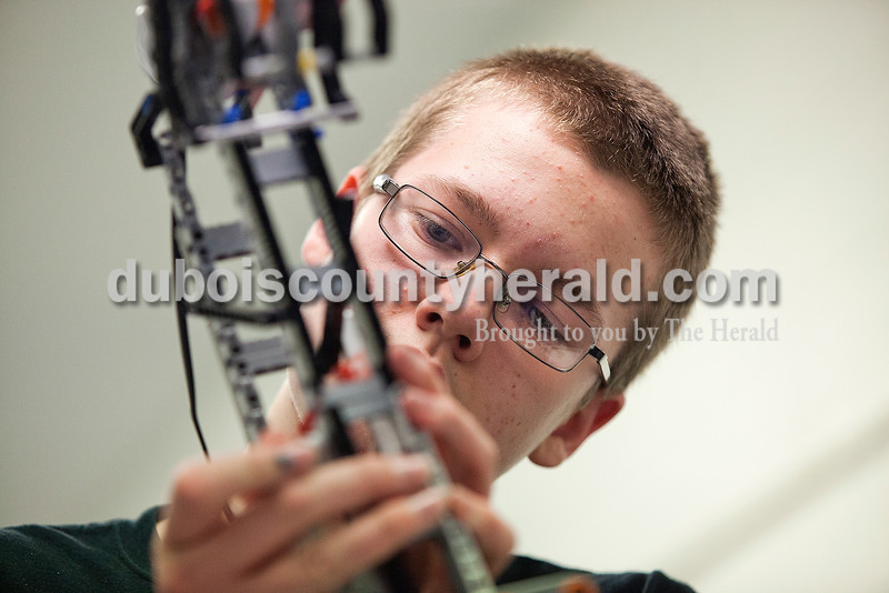 Rachel Mummey/The Herald<br /> Eighth-grader Ethan Wagner made adjustments on the robotics team's robot during their practice at Dubois Middle School on Thursday. The group, The Robot Renegades, will compete in a national competition at Lawrence Technical Institute in Michigan later this month.