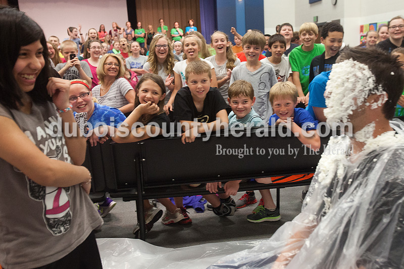 Rachel Mummey/The Herald<br /> Seventh-grader Lisette Moya, left, giggled with classmates after getting to throw a pie at her science teacher Ben Norwatarski between acts during the the talent show at Dubois Middle School on Friday. Students raised over $600 for their Robotics Club by buying one-dollar tickets to see their teachers get pied.