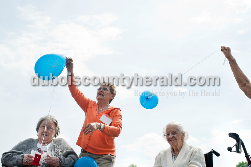 """Carolyn Van Houten/The Herald<br /> Bertha Buechlin, left, Activities Assistant Vicki Houchin of Winslow, Mary Heidorn and Evalene Hall waited to release their balloons at the Waters of Huntingburg on Monday.  Residents launched balloons to kick off National Nursing Home Week.  """"If the balloons are found, they have a card with the resident's name and our address, so that the balloon can be mailed back to us with a note,"""" Activities Director Lindsey Burger of Huntingburg said.  """"One year we got balloons back from as far as Kentucky."""""""