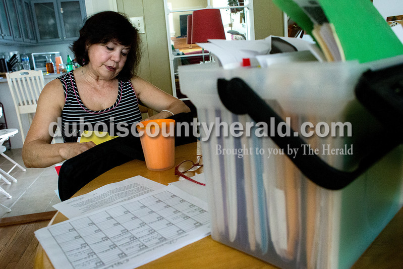 """Dave Weatherwax/The Herald<br /> Carol Gramelspacher of Jasper has power of attorney for her 29-year-old son who has been diagnosed with schizoaffective disorder. She keeps folders and a brief case full of papers that date back to Tyler's junior high years when Gramelspacher said signs of him being different started to show. """"This is my ammunition,"""" she said."""