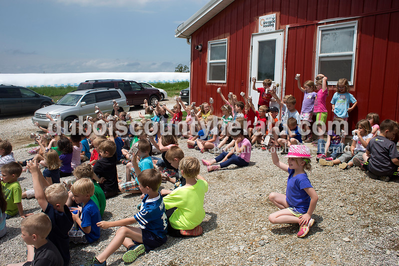 Dave Weatherwax/The Herald<br /> Ireland Elementary School kindergartners showed off the chocolate milk they enjoyed in front of the milking building on the Schwoeppes' dairy farm in Huntingburg on Tuesday.