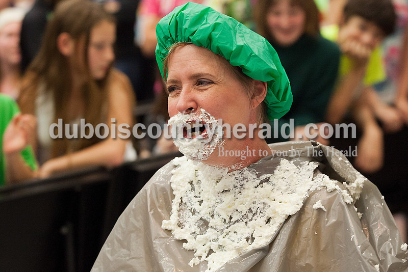 Rachel Mummey/The Herald<br /> Seventh-grade Language Arts teacher Linda Schmitt laughed after receiving a pie in the face between acts during the the talent show at Dubois Middle School on Friday. Students raised over $600 for their Robotics Club by buying one-dollar tickets to see their teachers get pied.