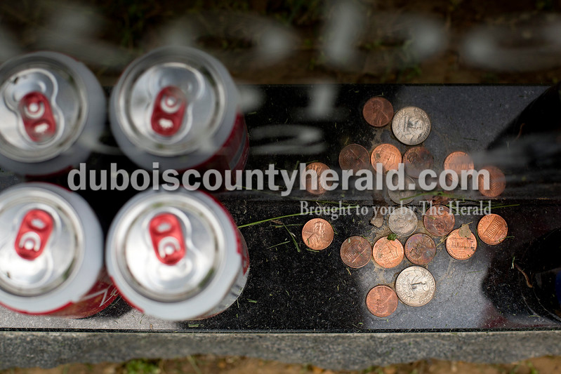 Dave Weatherwax/The Herald<br /> Several coins sat on the grave stone of Lance Cpl. Alec Terwiske which is said to indicate to his family that someone has visited the grave to pay respect. The coins are said to have distinct meaning, which vary depending on the denomination of the coin.