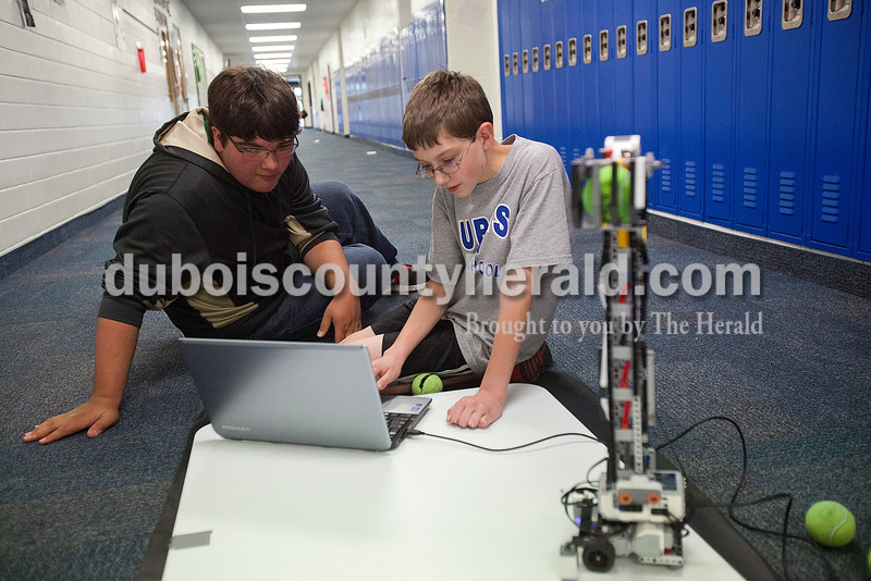 Rachel Mummey/The Herald<br /> Eighth-grader Justin Young, left and seventh-grader Joby Nelson worked together on the programming for the robotics team's robot during their practice at Dubois Middle School on Thursday. The group, The Robot Renegades, will compete in a national competition at Lawrence Technical Institute in Michigan later this month.