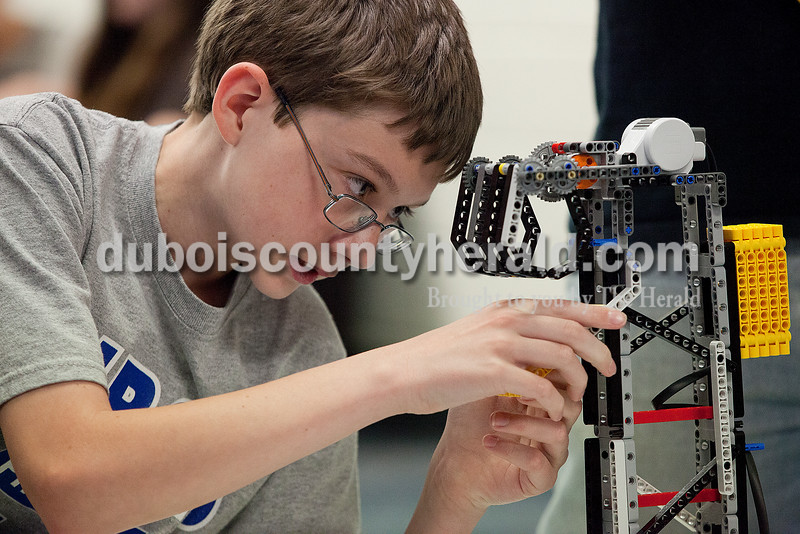Rachel Mummey/The Herald<br /> Seventh-grader Joby Nelson made adjustments on the robotics team's robot during their practice at Dubois Middle School on Thursday. The group, The Robot Renegades, will compete in a national competition at Lawrence Technical Institute in Michigan later this month.