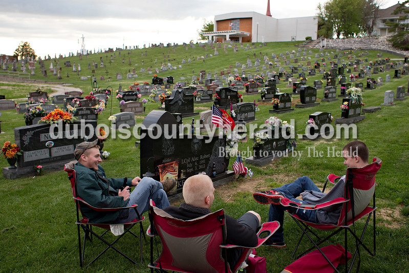 Dave Weatherwax/The Herald<br /> Tyler Lampert, left, and Logan Ingle, both of Dubois, and  Logan Borden of Jasper sat near the grave site of their high school buddy and fallen Marine Lance Cpl. Alec Terwiske of Dubois on May 1 in St. Celestine Cemetery in Celestine. The three friends said they and other friends will from time to time gather at Terwiske's grave site, sit in lawn chairs and just spend time visiting their buddy.