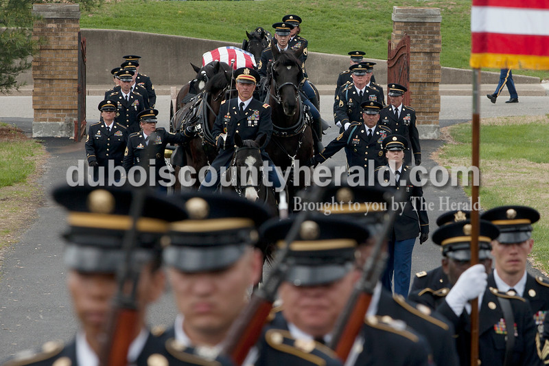 The Caisson procession for retired Maj. Gen. Robert J. Mitchell of the Indiana National Guard entered the Fairview Cemetery in Jasper on Friday. The funeral device took place at the Indiana National Guard. Heather Rousseau/The Herald