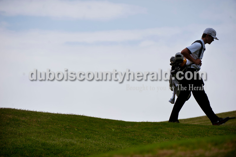 Carolyn Van Houten/The Herald<br /> Southridge's Mitch Steinkamp walked to a green during the tournament at Sultan's Run Golf Course in Jasper on Saturday.