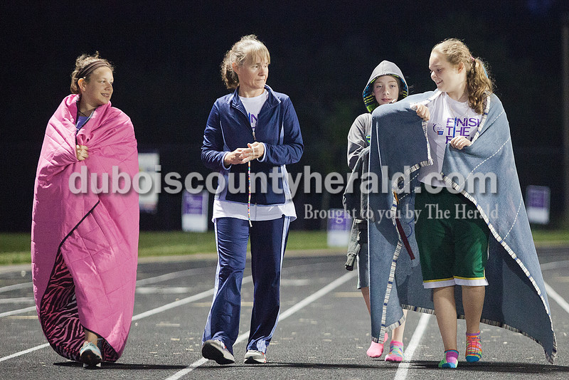 Sami Stout of Schnellville, 12, right, showed off a beetle that landed on her blanket while walking laps with her mother Sharon Stout, Shelby Hanna of Japser, 10, and Morgan Greulich of Ferdinand, 12, during Relay for Life of Dubois County on Saturday at Jasper Middle School. Rachel Mummey/The Herald