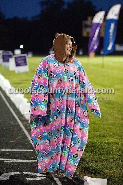 Tyan Mullen of Jasper donned a colorful bear snuggie during the pajama lap during Relay for Life of Dubois County on Saturday at Jasper Middle School. Rachel Mummey/The Herald