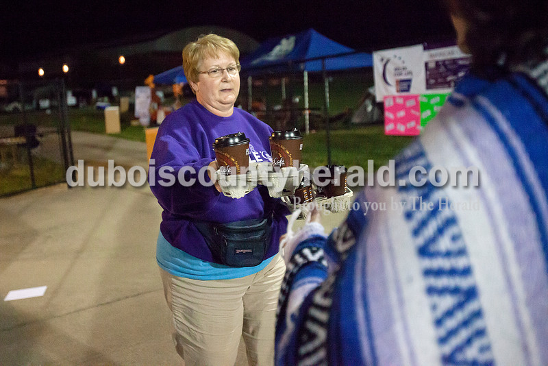 Diane O'Keefe of Jasper delivered coffee to relay participants after an early morning run during Relay for Life of Dubois County on Saturday at Jasper Middle School. Rachel Mummey/The Herald