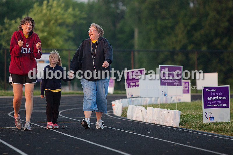 Julia Balbach of Evansville joked with Wilma Wendholt of Saint Anthony and her granddaughter Jordan Seherzer of Tell City, 6, as they continued walking laps during Relay for Life of Dubois County on Saturday at Jasper Middle School. Rachel Mummey/The Herald