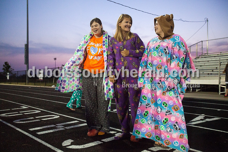 At dawn, Breanne Werner, left, Brook Altmann, both 16 and of Ferdinand, and Tyan Mullen of Jasper lined up for the pajama contest during Relay for Life of Dubois County on Saturday at Jasper Middle School. Rachel Mummey/The Herald