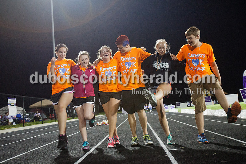 Diane Durcholz of Saint Anthony, 16, left, Kennedy Rainey of Ferdinand, 17, Morgan Wessel of Ferdinand, 16, Grant Winkler of Ferdinand, 16, Sam Wendholt of Brezville, 16, and Kade Boeglin of Ferdiannd, 15, attempted the can-can while making laps during the early morning hours at Relay for Life of Dubois County on Saturday at Jasper Middle School. Rachel Mummey/The Herald