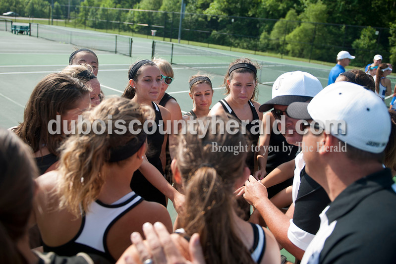 Carolyn Van Houten/The Herald<br /> The Wildcats huddled before the regional match in Jasper on Saturday.