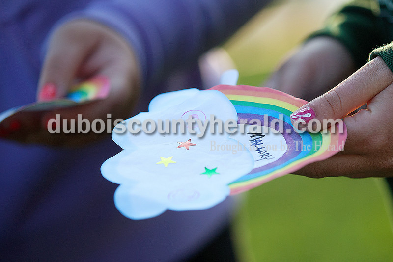 Mallory Dale of Ferdinand, 16, held out a paper to collect stickers  during Relay for Life of Dubois County on Saturday at Jasper Middle School. The stickers were used to collect dye for tie-dying t-shirts during the closing ceremony. Rachel Mummey/The Herald