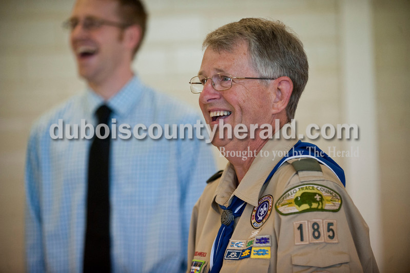 "Carolyn Van Houten/The Herald<br /> Eagle Scout Troop 185 leader Fred Feltner reacted to being presented with a plaque during a court of honor at St. Mary's Church in Ireland on Saturday.  Twenty-two seniors from his troop, all of whom are Eagle Scouts, surprised him with the plaque.  ""He has helped shape my character,"" 18-year-old Alex Erny of Jasper, who is one of the senior Eagle Scouts, said."
