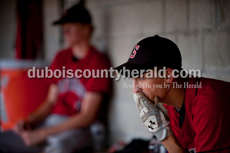 Carolyn Van Houten/The Herald<br /> The Raiders' Andrew Recker watched the Class 3A regional game from the dugout at Alvin C. Ruxer Field in Jasper on Saturday.  Southridge was defeated by Silver Creek 2-1.