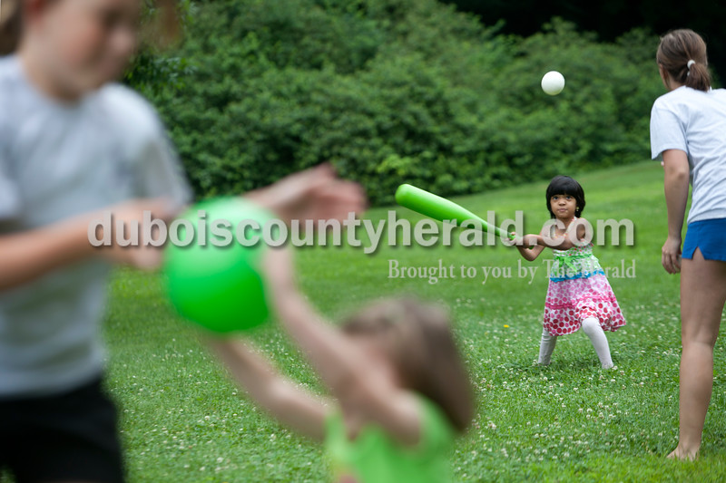 Heather Rousseau/The Herald<br /> Maci Buck, 11, left, played ball with her sister Maggie, 3, while Srishni Sabaeiraj, 4, was about to bat the ball after being thrown by Abby Pierce, right, all of Jasper,  while at the Arnold F. Habig Community Center in Jasper on Monday morning during Kamp 4 Kids which is put on by the Jasper Park and Recreation Department. The cost is $35 a week and takes place until the end of July. In addition to indoor and outdoor activities, the group  goes to the city pool once a week.