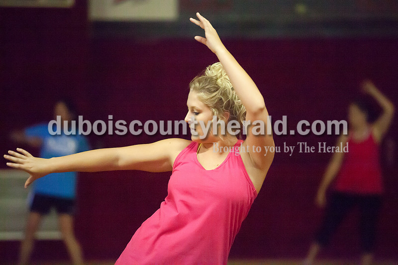 Rachel Mummey/The Herald<br /> Jordan Lindauer of Jasper danced during a Zumba class Wednesday at Skate Palace in Jasper. Lindauer said she's been doing Zumba for about two years.