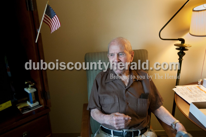 Heather Rousseau/The Herald<br /> Ambrose Pfister, 95, of Jasper moved into St. Charles Health Campus in January. He served in WWII and was stationed with the First Battalion 152nd Infantry headquarters and was in charge of communications. He smiled on Monday in his room as he recalled being picked for the job to type because he was one of the only ones who was somewhat familiar with the skill.