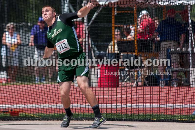 Forest Park's Noah Braunecker hurled a discus downfield during warm ups at the Indiana State Track and Field finals in Bloomington on Saturday. Braunecker finished in 22nd place with a throw of 136-03. Darryl Smith/For The Herald