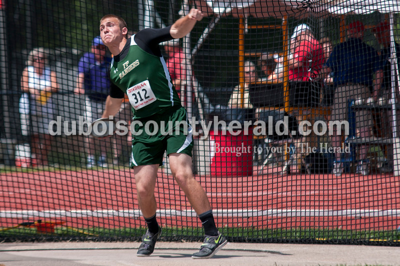 Forest Park High School Junior Noah Braunecker hurls a discus downfield during warm ups at the Indiana State Track and Field finals in Bloomington, Ind. on Saturday. Braunecker finished in 22nd place with a throw of 136-03.