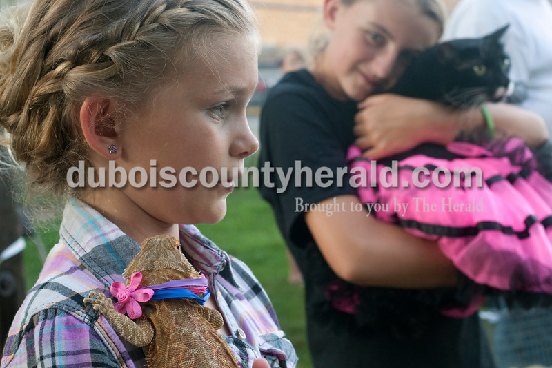 Heather Rousseau/The Herald<br /> Hannah Seifert, 10, of Jasper, held her pet bearded dragon, Spike, left, as Sydney Waddell, 12, of Ireland, hugged her cat, Felix who was wearing at tutu during the pet parade at the Kiwanis Kiddie Karnival at Jaycee Park in Jasper on Wednesday. Spike came in first for most unusual pet and Felix came in second place for prettiest.<br /> <br /> <br /> Caroline Kaiser, back left chatted with Kennedy Matheis, both 10 and of Jasper, on the benches at Jaycee Park in Jasper on Wednesday during the Kiwanis Kiddie Karnival. Both girls have been going to the Karinival every year for as long as they can remember.