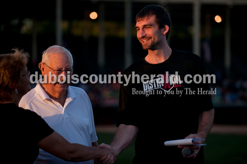 Carolyn Van Houten/The Herald<br /> Former Mr. Indiana Basketball and NBA player Luke Zeller, right, shook hands with Indiana Basketball Hall of Famers Marilyn Dippel, left, and Bob Sakel during the third annual Celebrating Fathers event at League Stadium in Huntingburg on Friday.  The event, which was sponsored by local businesses and churches, promoted and celebrated the role of fathers in the community.