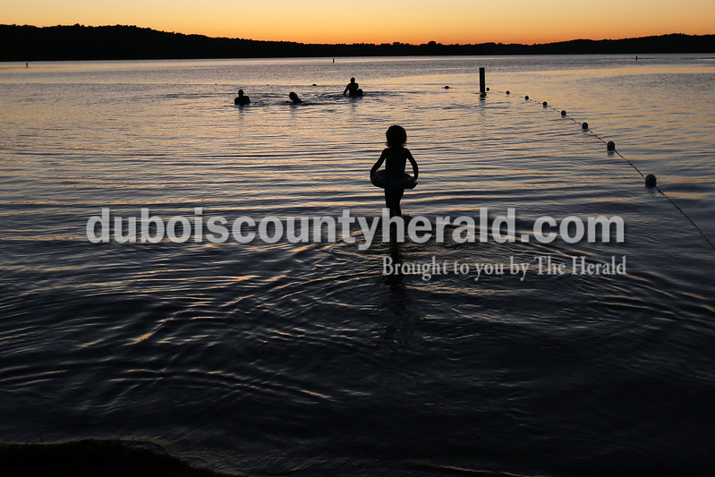 """Heather Rousseau/The Herald<br /> Kadence Meritdet, 3, ventured out into Patoka Lake during sunset to meet her mom, Jasmine Meritdeth, and family friends, all of Mitchell, on Saturday. They have gone swimming at Patoka twice this year and plan to go a lot more. """"""""When it's warmer, she loves it,"""" said Jasmine about her daughter."""